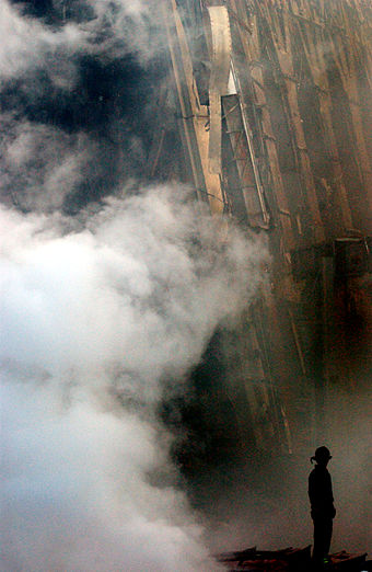 A fireman can be seen in silhouette at the base of the rubble. September 14 2001 Ground Zero 02.jpg