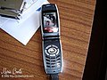 Sharp cellphone with dog image on screen.jpg