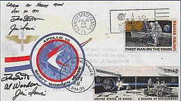Envelope with mission patch logo, three stamps and two postmarks