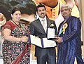 Smriti Irani presenting the Rajat Kamal Award to Francois Castellino (Best NarrationVoice Over) for the Non-Feature film – THE LION OF LADDAK, at the 65th National Film Awards Function, in New Delhi.JPG
