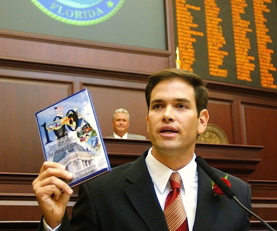 Speaker-designate Marco Rubio with a blank book titled 100 Innovative Ideas For Florida's Future