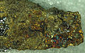 Sperrylite on chalcopyrite, Norilsk.jpg