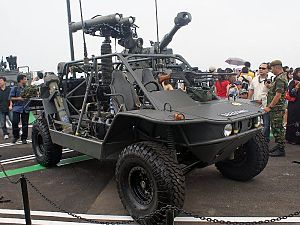 Singapore Guards - Light Strike Vehicle with SPIKE ATGM launcher extended.