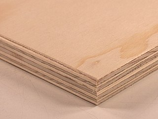Plywood manufactured wood panel made from thin sheets of wood veneer