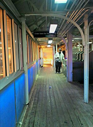 State/Lake station - A passenger enters the station as it appears quarter after 7 o'clock in the evening.