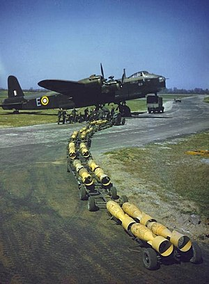 Nicholas Straussler - Short Stirling bomber being loaded with 250 lb bombs, carried on Alvis Straussler bomb trolleys.