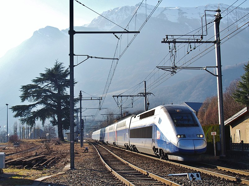 Sight of a French TGV Duplex, on winter service journey n°987 from Brest in Brittany to Bourg-Saint-Maurice in the Alps, here leaving Frontenex station and moving towards Albertville, in Savoie.