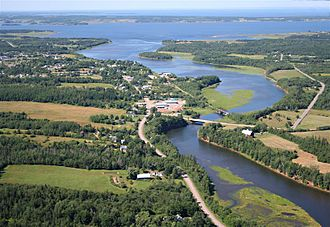 Tatamagouche - Aerial view of Tatamagouche, looking north-northwest down the Waugh River toward Tatamagouche Bay. Route 311 is in the foreground running along the riverbank.