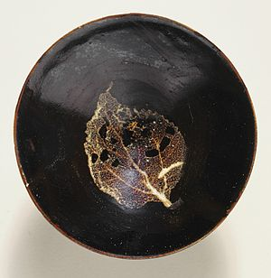 Jizhou ware - Tea bowl (from above), wheel-thrown stoneware with natural leaf resist decoration and brown glaze, late southern Song dynasty, about 1200–1279