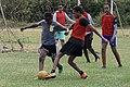 Teens battle for ball as teammates watch.jpg