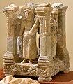 Temple model with goddesses. Goddess Fortuna holding a cornucopia. 2nd-3rd century CE. From Hatra, Iraq. Iraq Museum.jpg
