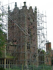 A view of the clock tower covered in scaffolding