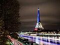 The Eiffel Tower lit in blue white red - Fluctuat nec mergitur.jpg