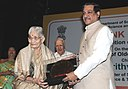 The Minister of State (Independent Charge) for Science & Technology and Earth Sciences, Shri Prithviraj Chavan presenting the Help Age India, Golden Award 2010, to Mrs. Vijaya Mulay (Educationist and Film Maker).jpg