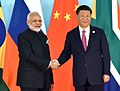 The Prime Minister, Shri Narendra Modi being welcomed by the President of the People's Republic of China, Mr. Xi Jinping, at the 9th BRICS Summit, in Xiamen, China on September 04, 2017 (1).jpg