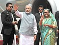 The Prime Minister, Shri Narendra Modi being welcomed by the Prime Minister of Bangladesh, Ms. Sheikh Hasina on his arrival, in Hazrat Shahjalal Airport, Dhaka on June 06, 2015 (2).jpg