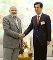 The Prime Minister, Shri Narendra Modi meeting the Mayor of Pohang, at Gimhae Air Base, Busan, South Korea on May 19, 2015.jpg