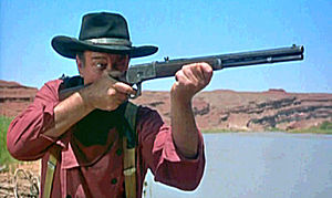 Winchester Model 1892 - John Wayne aims a Model 92 rifle in The Searchers (1956).
