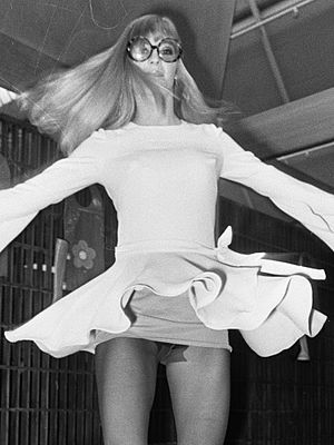 Miniskirt - 1969 Mary Quant minidress worn with pantyhose and roll-on girdle.