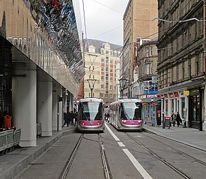 Two trams in Stephenson Street, geograph-5012475-by-John-Sutton.jpg