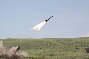 Mine-clearing line charge - Image: Type 92 Mine clearing vehicle launch its mine clearing line charges
