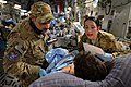 U.S. Air Force Capt. Mario Ramirez, left, and Capt. Suzanne Morris confirm a patient's identity and prepare to administer a blood transfusion during a medical evacuation flight out of Bagram Airfield, Afghanistan 130323-F-LR266-126.jpg