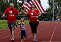 U.S. Air Force Master Sgt. Jason Aucoin, left, the wing ground safety officer for the 48th Fighter Wing Safety Office, runs with his wife, Tech. Sgt. Jennifer Aucoin, right, the training manager for the 48th 140911-F-FF749-655.jpg