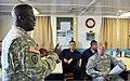 U.S. Army Maj. John Reynolds, left, a public affairs officer with the 311th Sustainment Command, provides media training to members of the 481st Transportation Company on board a landing craft utility in Port 130322-A-IO170-005.jpg