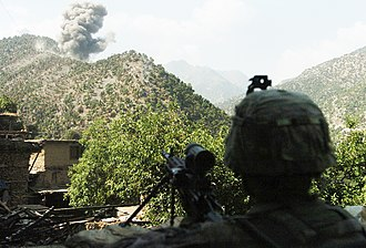 12th Infantry Regiment (United States) - A U.S. Army Soldier assigned to Company B, 12th Infantry Regiment watches as Air Force F-15E Strike Eagles bomb insurgent positions after a 20-minute gun battle in the Korengal Valley on August 13, 2009.