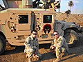 U.S. Army soldiers posing next to an uparmored Humvee in Iraq.jpg