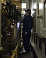 U.S. Coast Guard Electrician's Mate 3rd Class Christopher Blankenship inspects a machinery space on the maritime security cutter USCGC Bertholf (WMSL 750) during a drill as part of Arctic Shield 2012 while 120829-G-VS714-205.jpg