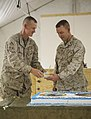 U.S. Marine Corps Maj. Thomas Siverts, left, the executive officer of the 1st Battalion, 9th Marine Regiment, hands a piece of cake to Lt. Col. Corey Collier, the commanding officer of the 1st Battalion, 9th 131111-M-WA264-005.jpg