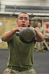 U.S. Marine Corps Pfc. Joe Hagedorn, with the command element of the 24th Marine Expeditionary Unit, participates in the combat conditioning portion of the Warrior of the Month event in the hangar bay 120501-M-RO494-067.jpg