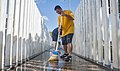 U.S. Navy Boatswain's Mate 2nd Class Louie Delacruz cleans the USS Oklahoma Memorial on Ford Island, Joint Base Pearl Harbor-Hickam, Hawaii, May 26, 2013 130526-N-WX059-050.jpg