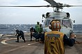 U.S. Navy Boatswain's Mate 3rd Class Guanqun Sun, foreground, acts as the landing signalman enlisted during a functional check flight of an SH-60B Sea Hawk helicopter assigned to Helicopter Anti-Submarine 120827-N-NL541-083.jpg