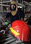 U.S. Navy Hull Maintenance Technician 2nd Class Derrick A. Stillwell puts on personal protective equipment during a general quarters training exercise aboard the aircraft carrier USS George H.W. Bush (CVN 77) 121203-N-VA840-009.jpg
