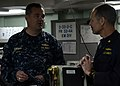 U.S. Navy Vice Adm. Tom H. Copeman III, left, the commander of Naval Surface Force, U.S. Pacific Fleet, talks with Lt. Cmdr. David Harris, the chief engineer of the amphibious transport dock ship USS Green Bay 130619-N-BB534-130.jpg