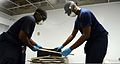 U.S. Sailors assigned to Strike Fighter Squadron (VFA) 146 assist with cleanup efforts at Naval Air Station Joint Reserve Base New Orleans Sept 120904-N-CT127-320.jpg