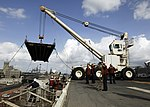 U.S. Sailors assigned to the amphibious assault ship USS Iwo Jima (LHD 7) lift the ship's brow from the pier before leaving Haifa, Israel, Sept 080919-N-KU661-146.jpg