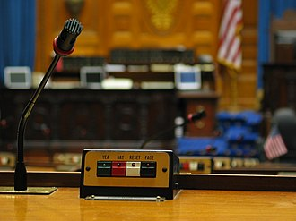 Massachusetts House of Representatives - Representatives' desk with microphone and voting buttons (yea/nay)