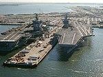 USS Enterprise (CVN-65) and USS Abraham Lincoln (CVN-72) tied up at Naval Station Norfolk on 25 September 1990 (6463991).jpeg