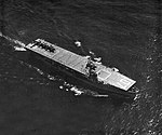 USS Gilbert Islands (CVE-107) underway at sea in 1954.jpg