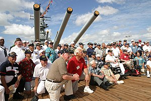 Former crewmembers of the battleship Missouri pose for photos shortly after the Anniversary of the End of World War II ceremony, held aboard the famous ship.