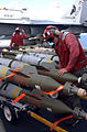 US Navy 020303-N-1587C-060 Loading bombs on aircraft at sea.jpg