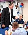 US Navy 021030-N-0967W-006 Michael Reagan chats with PCU Ronald Reagan Sailors.jpg