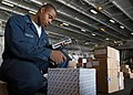 US Navy 040129-N-5952R-001 In the hanger bay aboard the nuclear-powered aircraft carrier USS Enterprise (CVN 65), Postal Clerk 3rd Class Bruce Johnson scans a package.jpg