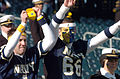 US Navy 041204-N-9815L-001 Midshipmen cheer from the stands at the 105th Army Navy game.jpg