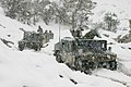 US Navy 041230-M-4697Y-045 Marines assigned to Weapons Company, 3rd Battalion, 3rd Marine Regiment, conduct a mounted patrol in the cold and snowy weather of the Khowst-Gardez Pass, Afghanistan.jpg