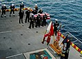 US Navy 050122-N-5517C-053 Executive Officer of the USS Tarawa (LHA 1) Capt. Peter D. Murphy and crewmembers stands at parade rest during a burial at sea ceremony.jpg