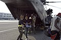 US Navy 050903-N-1467R-021 A Hurricane Katrina survivor smiles as she exits a U.S. Navy MH-53E Sea Dragon helicopter.jpg
